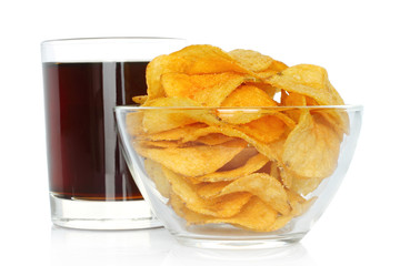 Glass of cola with potato chips on white background.