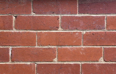 Closeup of Red Brick Wall Joined with Gray Cement