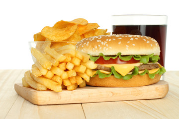 Hamburger, potato free and chips with cola on white background.