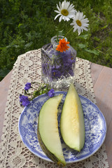 Still, slices of melon and flowers