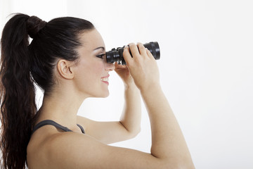 beautiful woman searching with binoculars