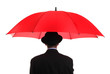 Businessman holding a red umbrella