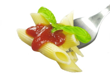 pasta with tomato sauce and basil on fork