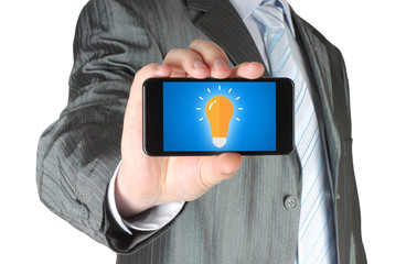 Man holds smart phone with idea concept on white background .