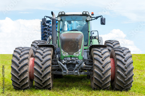 Foto Spatwand Trekker - Front of big tractor. - Foto4art.be