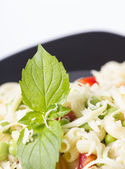 Spiral pasta with fresh vegetables  and cheese