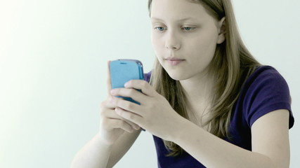 Teen girl using mobile phone
