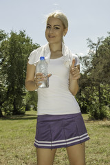 young beautiful woman holding a bottle of water