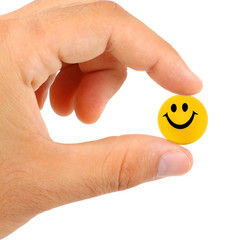 Ball with smile between the fingers