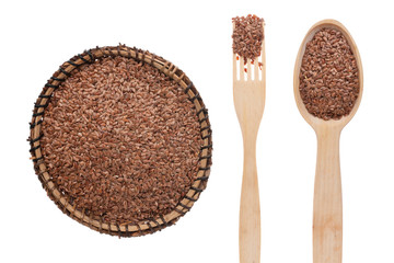 Flax seed in a plate, fork and spoon