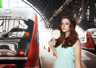 Woman on a Platform with Train. Expectation