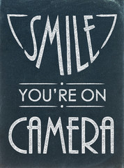 Smile, You're on Camera (poster chalkboard warning)
