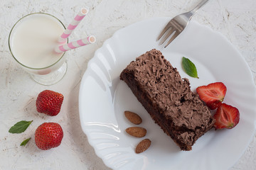 Homemade Chocolate Cake with Strawberries, Almonds and Milk