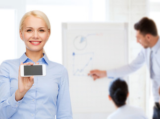 smiling businesswoman with smartphone blank screen