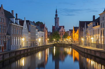 Bruges - Canal and Spigelrei street at dusk