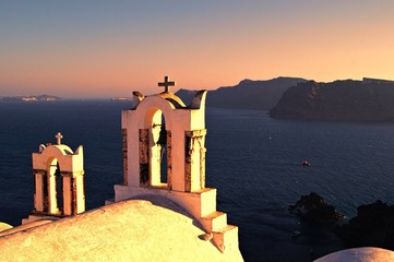 Church bells of Santorini Greece overlooking the sea at sunset