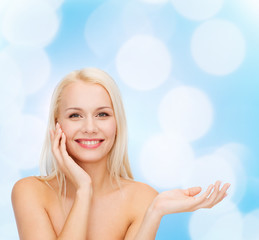 smiling woman holding imaginary lotion jar