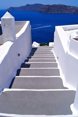 Classic white staircase towards the sea at Santorini, Greece