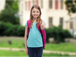smiling girl with school bag showing thumbs up