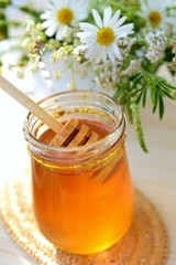 Jar full of honey and chamomile