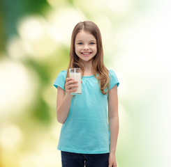 smiling little girl with glass of milk