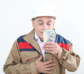 man in uniform with white construction helmet and holding money