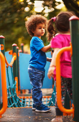 Afro American kids on playground in kindergarten