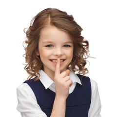 pre-teen girl showing hush gesture