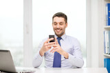 businessman with laptop and smartphone at office