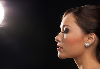 profile portrait of woman with diamond earrings