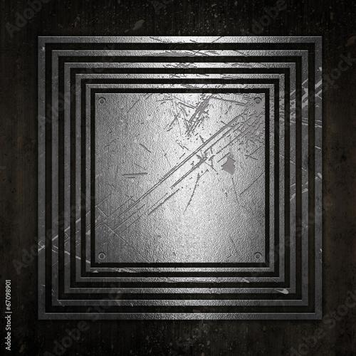 Metallic plate on a grunge background