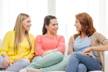 three girlfriends having a talk at home