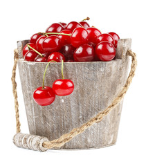 Fresh cherries in a wood bucket