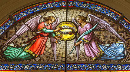 Brussels  -  Angels from windowpane in St. Jacques Church