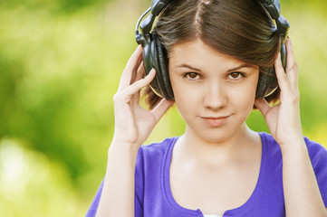 close-up portrait of young woman wearing headphones