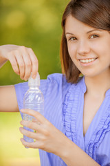 woman close-up holding bottle of water