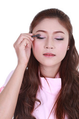 woman applying eyeshadow powder