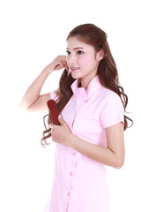 woman brushing her hair on white background