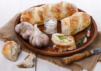 Freshly baked bread rolls and garlic