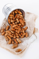 Roasted peanuts in shells over white background
