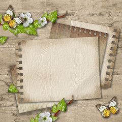 Blank paper with blossoming cherry branch and butterfly  on wood