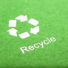 recycle symbol on cardboard green