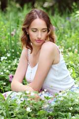 Girl in flowerbed