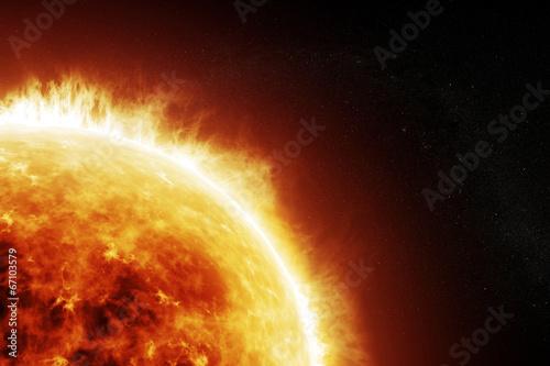 Leinwanddruck Bild Burning sun on a space black background