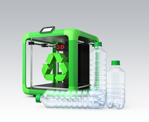 3D printer and recycle mark, PET bottles on gray background