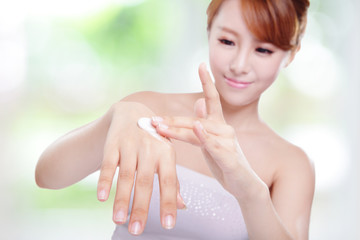 woman applying hand cream