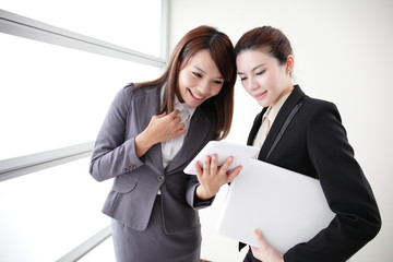 Business women look and smile conversation