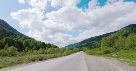 Beautiful summer landscape with a road running between the mount