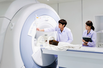 veterinarian doctor working in MRI scanner room