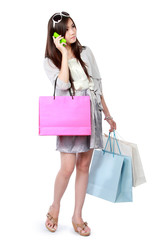 woman with shopping bags using cellphone
